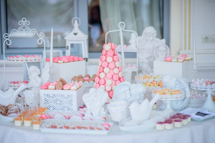 Beautiful candy bar of pink and white sweets decorated with figu